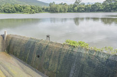 Old spillway on concrete small dam Royalty Free Stock Images