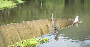 Old spillway on concrete small dam Stock Image