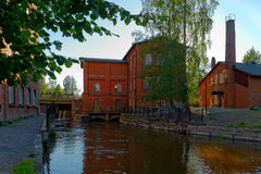 Old spinning mill buildings of red brick Stock Photos