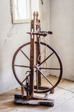 Old spinning wheel Stock Images