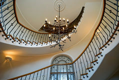 Old spiral staircase in classic russian manor style Royalty Free Stock Photo