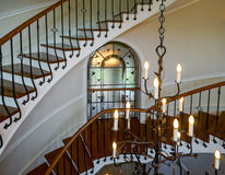 Old spiral staircase in classic russian manor style Stock Photo