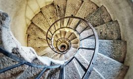 Old spiral staircase. A stone spiral staircase in an old church stock image