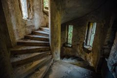 Old spiral staircase in tower of abandoned mansion.  royalty free stock photo