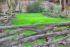 Old Split Log Fence in a Decorative garden Stock Images