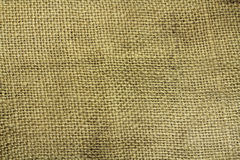 Old spoiled canvas burlap. Background stock images