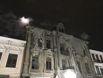 Old spooky hotel in the night. Old hotel spooky in the night old architecture many windows stock image
