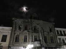 Old spooky ruin hotel in the night. Old hotel spooky in the night old architecture many windows royalty free stock photography