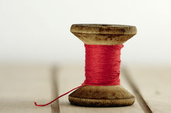 Old spool of thread Stock Photography