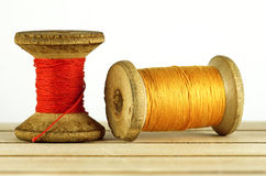 Old spool of thread Stock Images