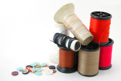 Old spools of colored thread Stock Photos