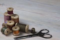 Old spools of thread on wooden background Royalty Free Stock Image