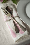 Old Spoon and Fork on Rolled Table Napkin Stock Photo
