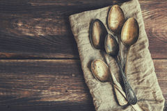 Old spoons piled on rustic wooden background Stock Image