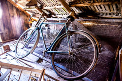 Old sport bicycle left in village loft Stock Images