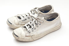 Old sport shoes on white background Stock Image