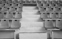 Old sport tribune with empty chairs. Empty seats at the sports stadium. Black and white image Stock Image