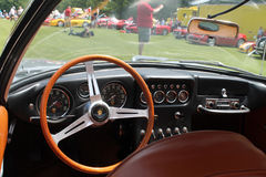 Old sports car cockpit Stock Photography