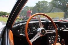 Old sports car cockpit. Interior cabin seen through window. 1960s silver Lamborghini 350 gt superleggera sports car. 2013 belle macchine ditalia, poconos Royalty Free Stock Photo