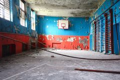 Old sports hall at school with a basketball. Basketball and  gym at thrown school Royalty Free Stock Photography