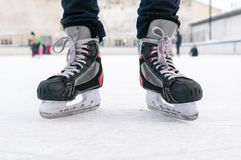 Old sports hockey skates. on a man`s leg. on the ice. royalty free stock photo