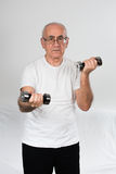 Old sportsman with dumbbells Stock Images