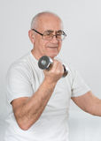 Old sportsman with dumbbells Royalty Free Stock Images