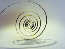 Old spring on the pendulum in the form of a spiral is the heart of the watch Royalty Free Stock Photography