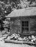 Old springhouse in Middleburg. Old springhouse with some summer flowers in Middleburg Virginia Royalty Free Stock Images