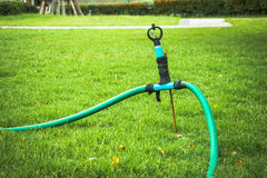 Old sprinkler modify on grass Royalty Free Stock Images