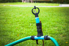 Old sprinkler modify on grass Stock Photo