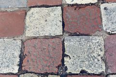 Old square tiles in a checkerboard pattern lying. On the area of Montenegro in Kotor Royalty Free Stock Images