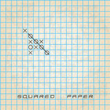 Old squared paper background with noughts and crosses Stock Photo