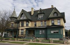 Old St. Cloud Mansion. This is a Spring picture of an agin Queen Anne mansion featuring elaborate gables and a turret located in St. Cloud, Minnesota in Stearns Royalty Free Stock Image