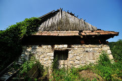 Old stable. The facade of a very old and abandoned stable in Sub Piatra village, Romania Stock Photography