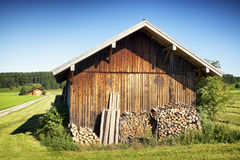 Old stable. And firewood at a meadow Royalty Free Stock Image
