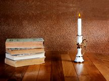 Old stack of books with candlestick Stock Image