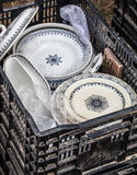 Old stack of white and blue plates at flea market Stock Image
