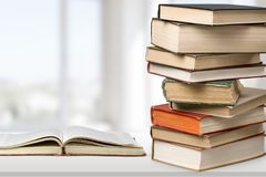Old stacked books on light background. Old stacked books background paper art abstract Stock Image