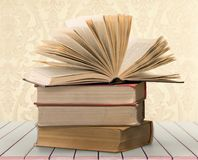 Old stacked books on wooden table. Old stacked books background paper art abstract Stock Image