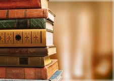 Old stacked books on blurred background. Old stacked books background paper art abstract Royalty Free Stock Photos
