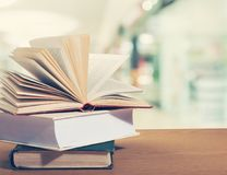 Free Old Stacked Books On Wooden Table Royalty Free Stock Photos - 112029378