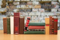 Old stacked books on wooden table. Old stacked books background paper art abstract Royalty Free Stock Photo