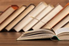 Old stacked books on wooden table. Old stacked books background paper art abstract Royalty Free Stock Image