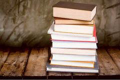 Old stacked books on wooden table. Old stacked books background paper art abstract Royalty Free Stock Images