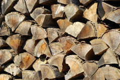 Old stacked firewood. Old stacked weathered firewood in countryside closeup stock image