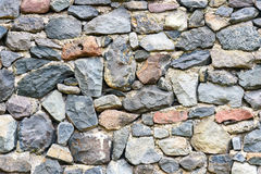 Old stacked stone wall of fortress Stock Photo