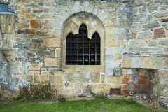 Old stacked stone wall with window Royalty Free Stock Images