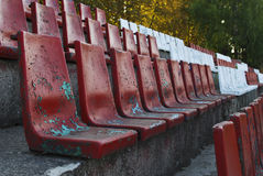 Old stadium chairs. Rows of red and white color old seats (chairs) in the stadium Royalty Free Stock Photography