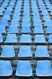 Old stadium tribune. Industrial architecture shot detail with empty old stadium blue tribune Royalty Free Stock Photos